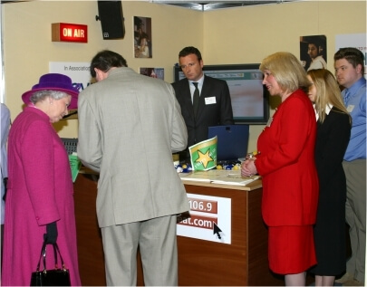 Her Majesty the Queen with Robert Owen visiting the hertbeat FM booth. Stevenage 2002